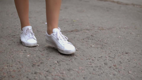 female legs going on street Live Action