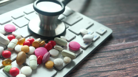 Close up of pills and stethoscope on keyboard Live Action