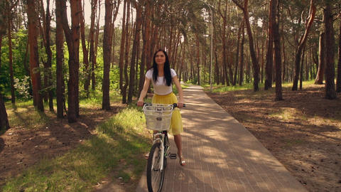 adult female cycling on bicycle outdoors Live Action