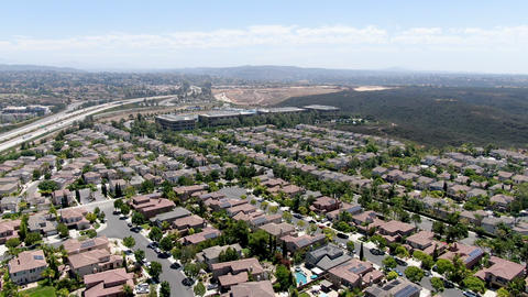 Aerial view of middle class subdivision neighborhood with residential villas Acción en vivo