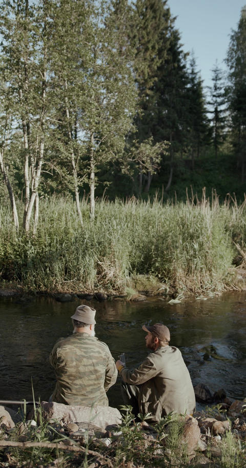 Two Persons Fishing in the River While Talking to Each Other 3 Live Action