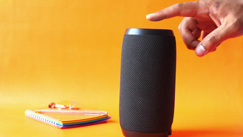 man's hand using smart speaker close up Live-Action