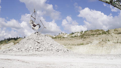 industrial extraction of chalk in a large open pit. excavator pours a pile of ライブ動画