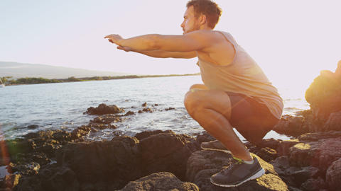 Fitness athlete man doing squats exercise outside Live Action