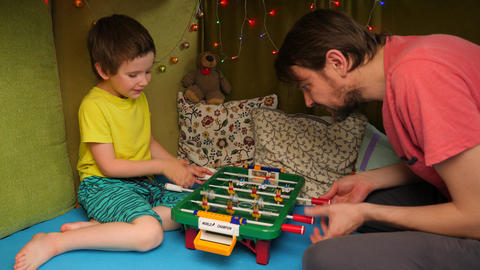 Father and son spend time together indoor by playing table football. Emotional ライブ動画