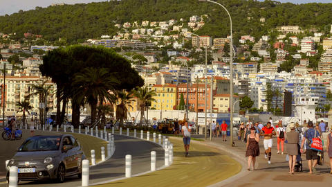 Walking along the seafront of Nice at the Cote D Azur - CITY OF NICE, FRANCE - Live Action