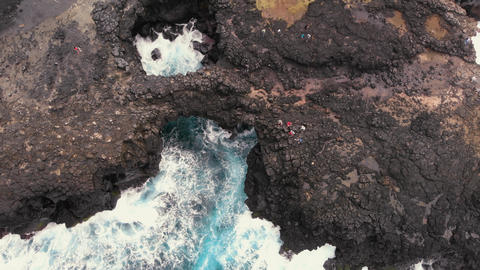 Overhead aerial view of Pont Naturel rock formations in Mauritius, view from a Live Action