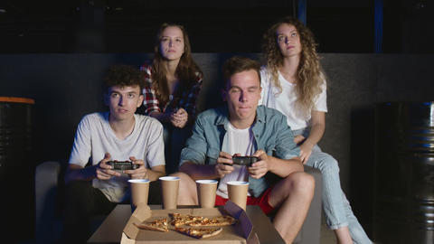 Young upset friends are losing video game at home GIF