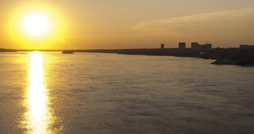 wide river with sailing motorboats reflects bright sunlight GIF