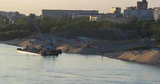 barge crane works at bank of industrial district near river ライブ動画
