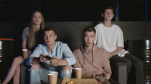 Friends having sad with video game at home, young men losing game GIF