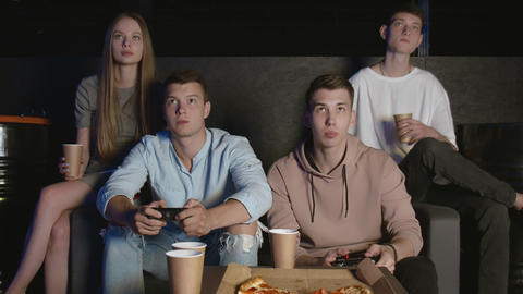 Home party of friends have a fun time together eating pizza and playing on a GIF