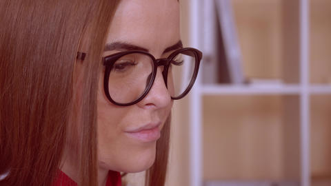 closeup portrait female in eyeglasses Live Action