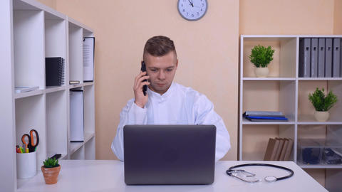 smiling man has phone conversation on mobile Live Action