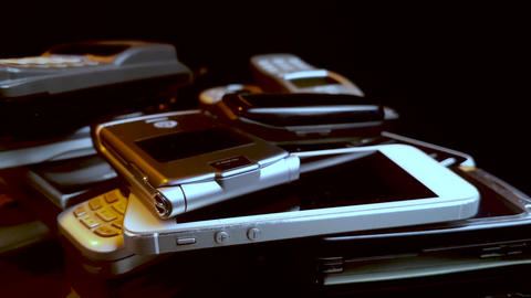 Vintage Cellular Phones on Spinning Display Close Up, Motorola iPhone Ericsson Live Action