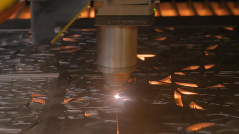 Laser cutting machine working with sheet metal with sparks - close up Live Action