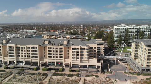Glenelg, Australia. Aerial view of cityscape and coastline on a sunny day Live Action