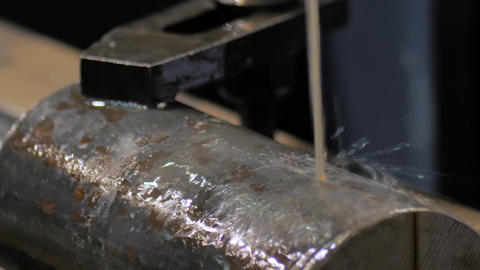 Wire cutting machine working with metal workpiece with sparks: slow motion Live Action