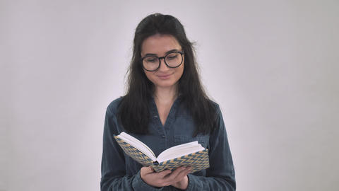 Caucasian student reads indoors Live Action