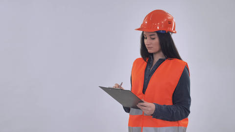 Caucasian manager wearing hard hat fill form Live Action