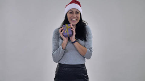 smiling girl santa catches present present Live Action