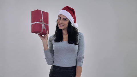 smiling girl celebrating new year throwing present Live Action