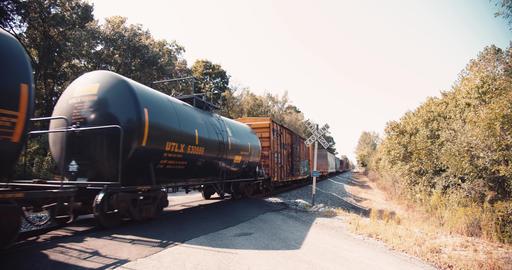 A Cargo Train Passing Through A Railroad Crossing ライブ動画