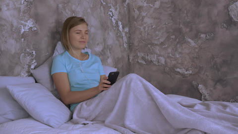 millennial in bedroom with gadget Live Action