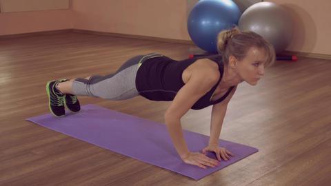girl doing physical exercises for strengthen the chest ライブ動画