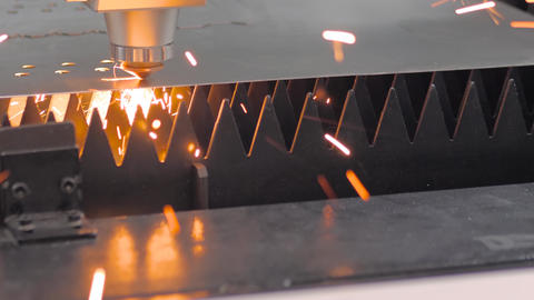 Laser cutting machine working with sheet metal with sparks at factory Live Action