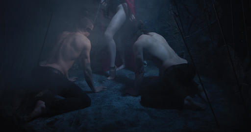 Horror movie, succubus is holding two blindfolded men on leashes, 4k ライブ動画