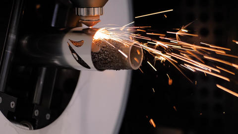 Laser cutting machine working with metal workpiece with sparks at factory Live Action