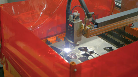 Laser cutting machine working with sheet metal with sparks Live Action