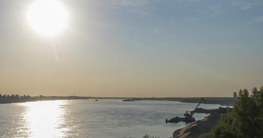 barge crane at wide calm river with sunlight reflections ライブ動画