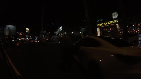 A slowmotion of night traffic jam at the downtown in Ho Chi Minh Acción en vivo