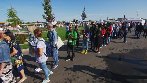 people queue waits for Skyway suspension railway exhibition GIF