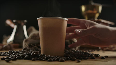 Fingers depicting a man walk to brown paper cup. Coffee take away ライブ動画