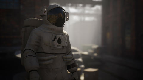 Lost Astronaut near Abandoned Industrial Buildings of Old Factory GIF
