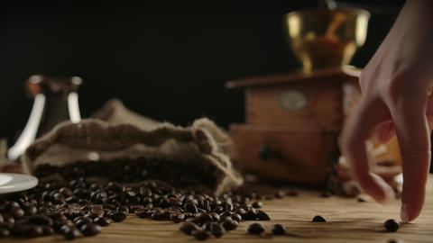 Imitating human fingers walk over coffee beans. Funny concept for enjoy coffee ライブ動画