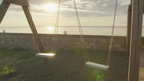 Slow motion, Empty swing set swing, silhouette at sunset ライブ動画