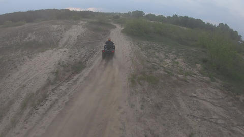 High angle view on an ATV racer driving off-road, high speed. extreme sport Live Action