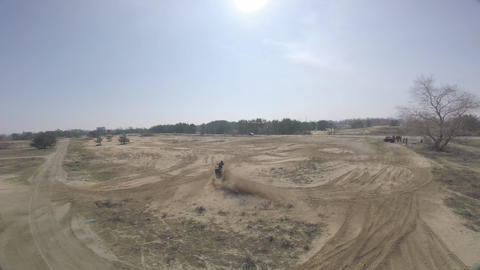 Dynamic footage of an ATV drifting and bursting dust, FPV drone Live Action