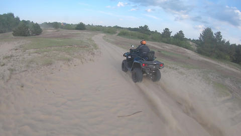 ATV is driving off-road bursting dust, high speed filming with an FPV drone Live Action