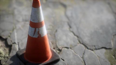 orange and white striped traffic cone Acción en vivo