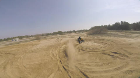 Drifting in the dust on an ATV, aerial footage with an FPV drone Live Action