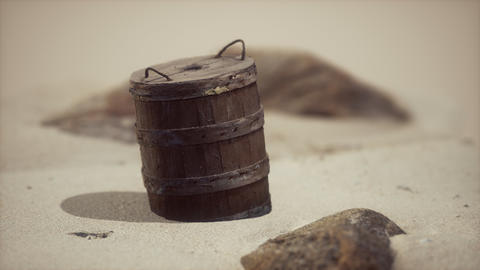 old wooden basket on the sand at the beach GIF