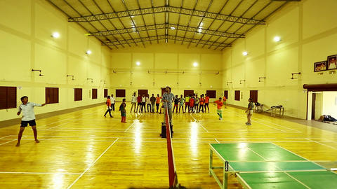 Badminton courts with players competing in indoor, Asia-India Footage