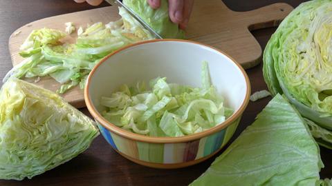 Iceberg lettuce fresh salad leaves.The geometric patterns of the leaves inside the heart of a cut ライブ動画