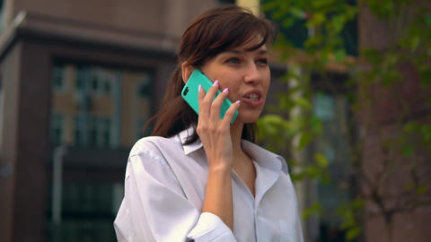 cheerful woman using smartphone has phone conversation Live Action