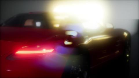 luxury sport car in dark studio with bright lights GIF